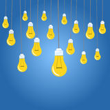Yellow light bulbs illustration on blue background Stock Images