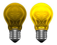 Yellow light bulbs, one glowing, another not Stock Photography
