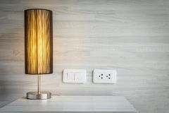 Yellow light decoration in bed room with switch and electric plug connector. Bed room background concept stock photos