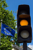 Yellow light and European Union flag Royalty Free Stock Image