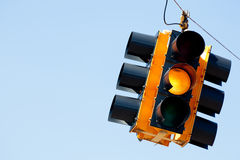 Yellow light traffic signal with copy space. A yellow light traffic signal with blue sky copy space Stock Photo