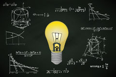 Yellow lightbulb on blackboard with math calculations  Stock Photography