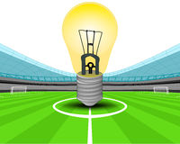 Yellow lightbulb in the midfield of football stadium vector Stock Photo