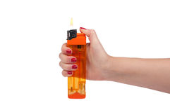 Yellow lighter in hand Royalty Free Stock Photo