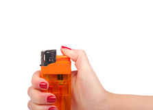 Yellow lighter in a hand Stock Image