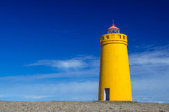 Yellow lighthouse and clear blue sky Stock Photography