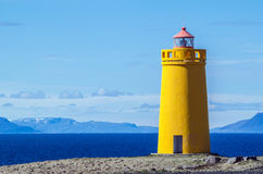 Yellow lighthouse and on a clear and sunny day Royalty Free Stock Image