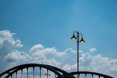 Yellow lighting street poles over the bridge. With blue sky royalty free stock photography