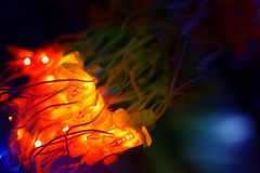 Yellow Lights Flower. A bunch of yellow lights line looking like a bright flower, lit up on the festive occasion of Diwali / Christmas in India Stock Photo