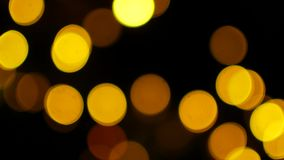 The yellow lights of the garlands in the defocus blink like bokeh.  stock video