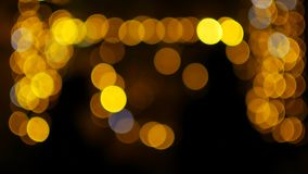 The yellow lights of the garlands in the defocus blink like bokeh.  stock footage