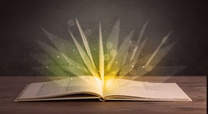 Yellow lights over book Royalty Free Stock Images