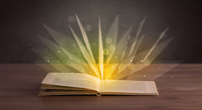 Yellow lights over book Royalty Free Stock Image