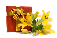 Yellow lily and gift box Stock Images