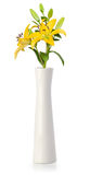 Yellow lily in white vase Royalty Free Stock Photography