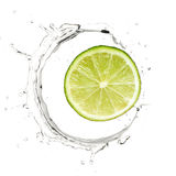 Yellow lime in water splash. Slice of green lime in water splash Stock Images