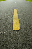 Yellow Line. A yellow line line in the middle of a road stock photo