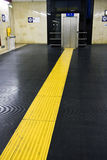 Yellow line. A yellow line conduces at the elevator royalty free stock photography