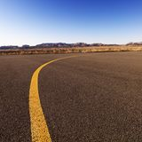 Yellow line on airport tarmac. Royalty Free Stock Images