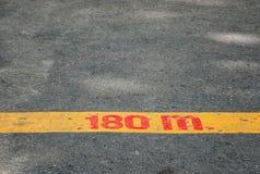 Yellow line on asphalt background Stock Images
