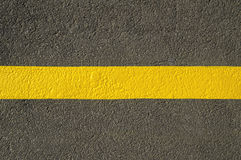Yellow line on asphalt detail. Stock Photography