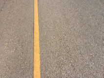 Yellow line on concrete road Stock Photography