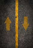 Yellow line on the high way with airrow up and down. Stock Photos