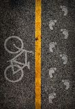 Yellow line on the high way saperate for bicycle and walk lane. Used film filter for old color tone Stock Photos