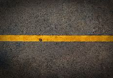 Yellow line on the high way. Used film filter for old color tone Royalty Free Stock Photo