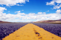 The yellow line on the highway in Tibet Stock Photos