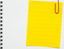 Yellow line memo paper clipped on white notebook Royalty Free Stock Photos