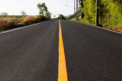Yellow line on the  road. Yellow line on the new road Stock Photography