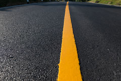Yellow line on the  road. Yellow line on the new road Royalty Free Stock Images