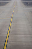 Yellow line on the plane runway in Shanghai Airport Stock Photography