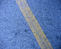 Yellow line on the road. As indication for any kind of traffic regulations Royalty Free Stock Images