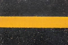 Yellow line  on road Stock Images