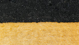 Yellow line on the road. Texture Royalty Free Stock Photography