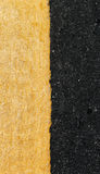 Yellow line on the road. Texture Royalty Free Stock Image