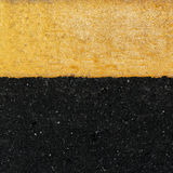 Yellow line on the road. Texture Stock Photography