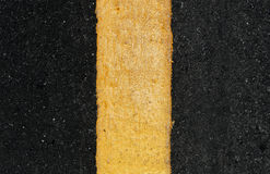 Yellow line on the road Royalty Free Stock Photos