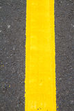 Yellow line on the road Royalty Free Stock Photo