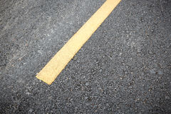 Yellow line on road texture Stock Photography