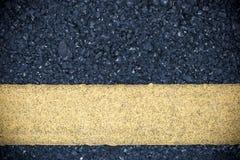 Yellow line on road texture Stock Photos