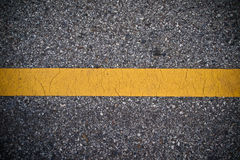 Yellow line on the road texture Stock Images