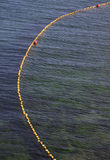 Yellow line on the sea Stock Images