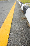 Yellow line on street and footpath Royalty Free Stock Photography