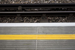 Yellow line on a train platform Royalty Free Stock Image