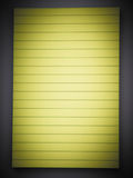 Yellow lined note pad Royalty Free Stock Photos