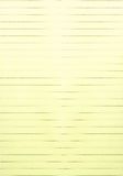 Yellow lined paper Stock Images