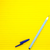 Yellow lined paper with blur pen. Copy space Stock Image